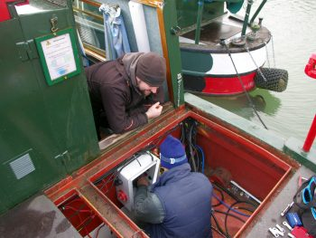 Volunteers maintaining the boat