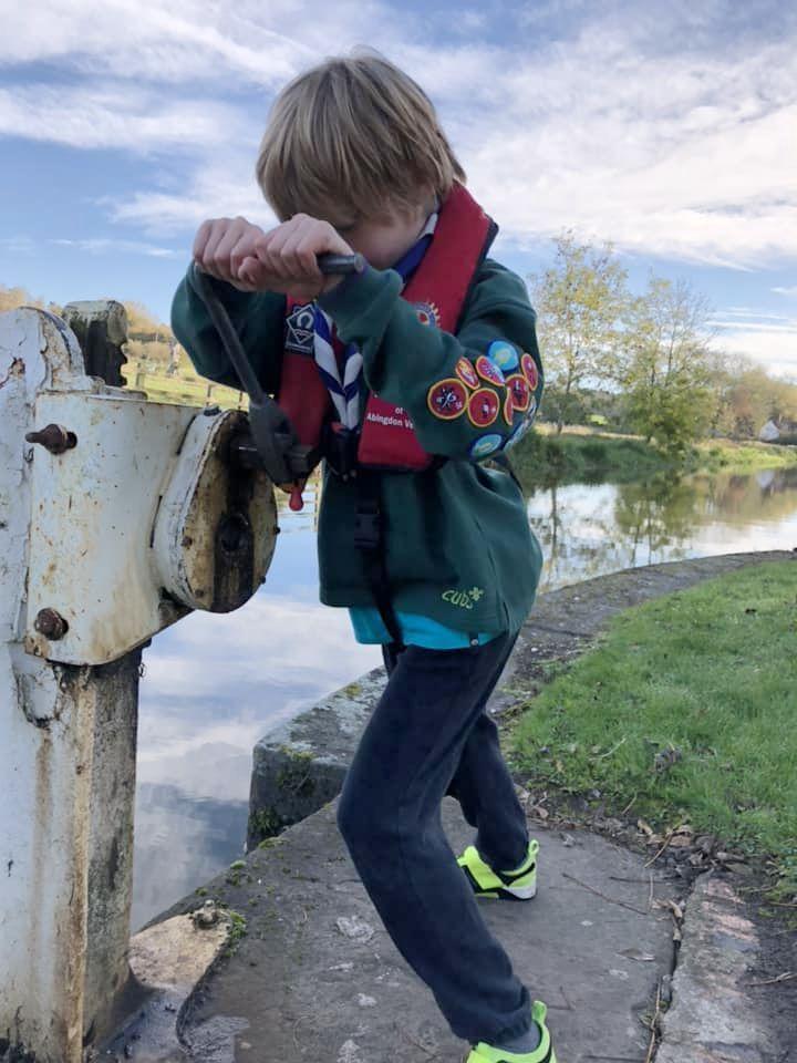 Boy turning a lock